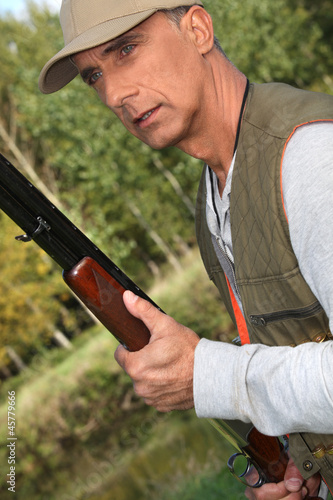 Hunter with a shotgun