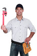 Man with an adjustable wrench