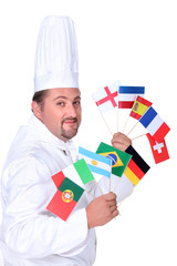 Chef holding up flags from around the world