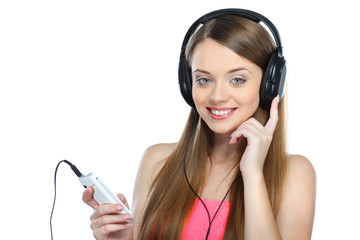 Beautiful girl with headphones listening music isolated