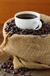 Linen bag of coffee beans and a cup of espresso