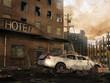 Ruiny hotelu ze starym samochodem