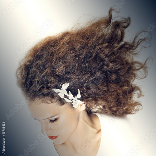 Curly hair elegant woman hairstyle