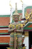 Stone guardian of Wat Phra Kaew temple next to the Bangkok Grand