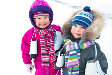 Little skaters in wintertime