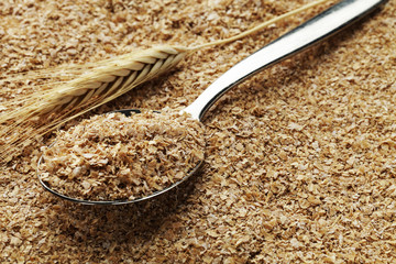 wheat bran on a spoon