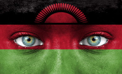 Human face painted with flag of Malawi