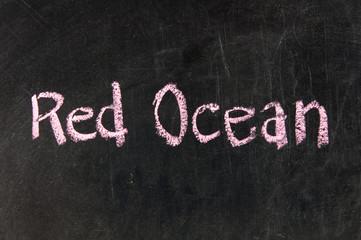 red ocean strategy written on blackboard
