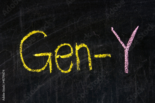 The word GEN-Y handwritten with chalk  on a blackboard