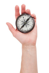Vintage compass in hand