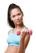 Athletic young woman exercises with pink weights