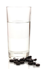 glass of water and activated carbon isolated on white