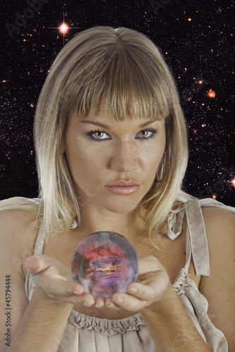 fortune teller holding a crystal ball