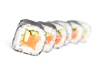 Row of maki sushi rolls, isolated on white.