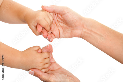 Mother and babies hands together.