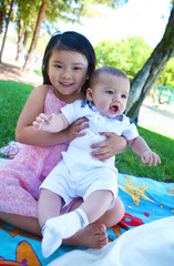 Cute Brother and Sister in Park