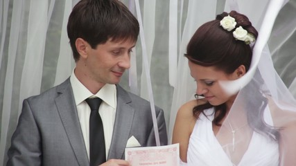 The bride and groom received a document of marriage