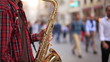 man play saxophone on the street