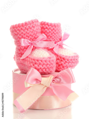 pink baby boots and gift isolated on white