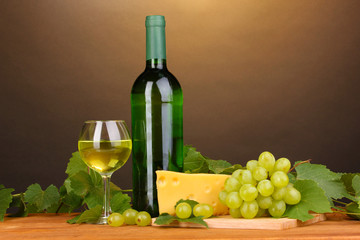 Bottle of great wine with glass and cheese