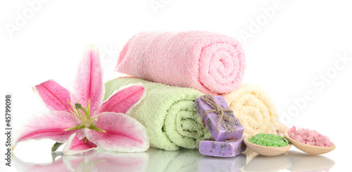 towels with beautiful pink lily, aroma oil and sea salt