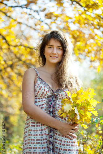 woman with oak leaves posy