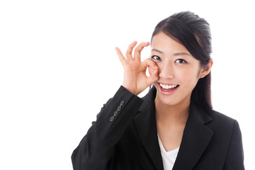 asian businesswoman showing okay sign on white background