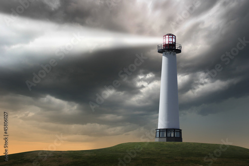 Lighthouse beaming light ray over stormy clouds