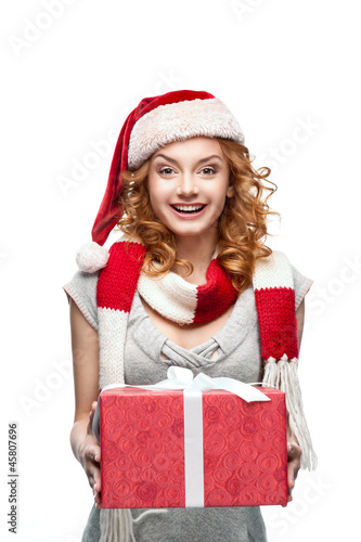 young red-haired happy smiling girl holding christmas gift