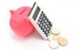ぶたの貯金箱と電卓とお金