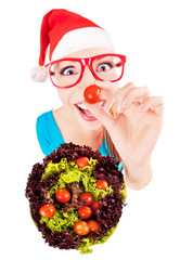 Funny santa girl playing with salad