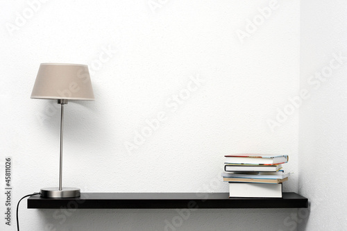 bookshelf on the wall with lamp and books - 45811026
