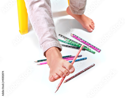 Child's feet  performing gymnastic with pencils