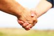 Leinwandbild Motiv Closeup of people shaking hands