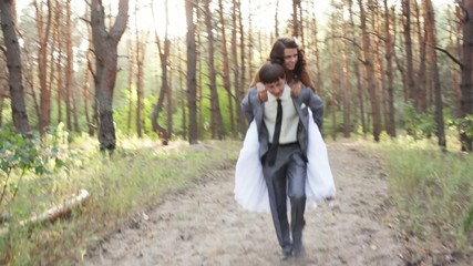 Groom carries his bride
