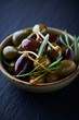 Marinated olives and caper berries with rosemary