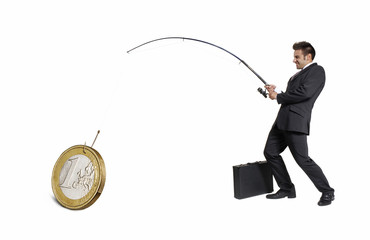 Ejecutivo atrapando,pescando un euro,concepto de negocios.