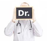 Doctor shows information on blackboard: dr