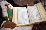 Korans in the hands of a Muslim