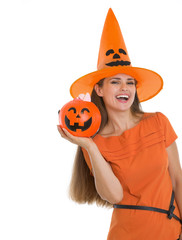 Happy woman holding Halloween bucket