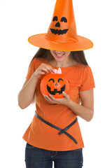 Woman holding Halloween bucket with sweets