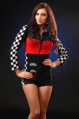 girl in a racing suit on a black background