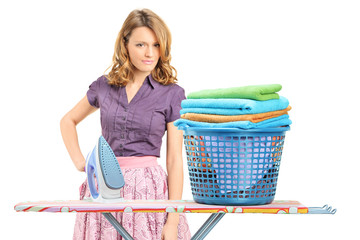 A beautiful female posing after ironing clothes