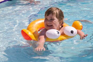 Happy child in pool
