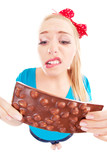 Funny unhappy girl with a chocolate isolated on white