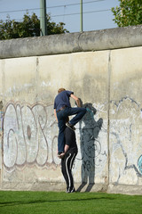Berlin wall - trying to climb over