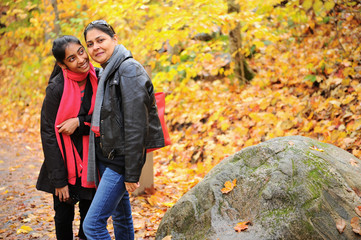 Loving mother and daughter enjoying autumn