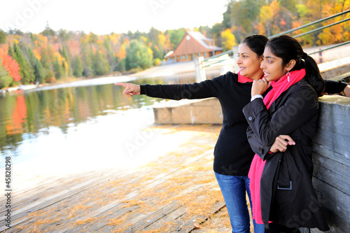 Loving mother and daughter enjoying autumn