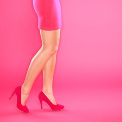 Legs and pink high heels shoes