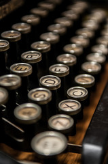Old antique typewriter keyboard with shallow depth of field.